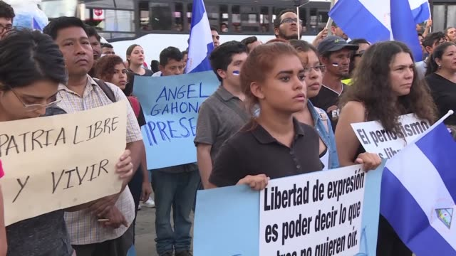 nicaraguans hold a protest and vigil in the capital managua in tribute to the slain journalist angel gahona who was shot during the recent protests... - managua stock videos & royalty-free footage