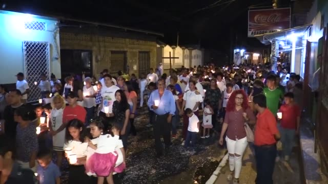 nicaraguans march in a holy week procession of silence to a church to mark one year since the country was gripped by political crisis and months of... - holy week stock videos & royalty-free footage