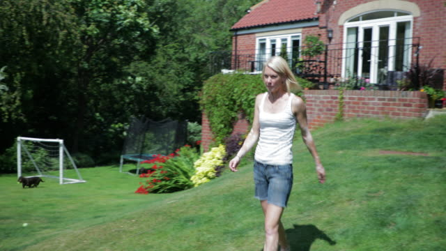 nice day to be working in her garden - vest stock videos & royalty-free footage