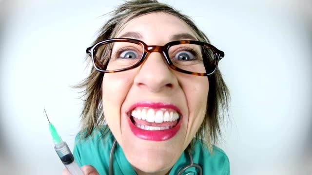 nice nurse turns crazy with syringe fisheye video - insanity stock videos & royalty-free footage