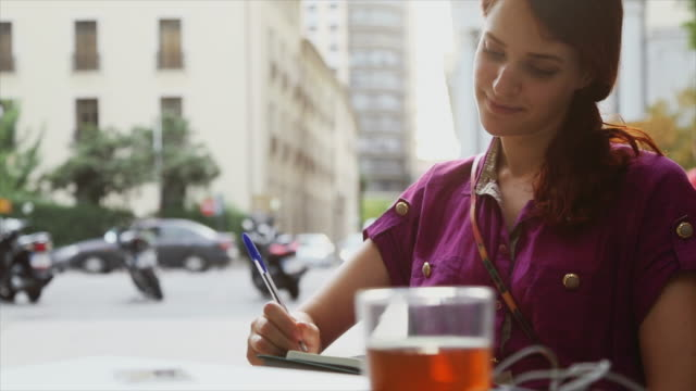 nice woman drawing on a sketchbook outdoor at bar - drawing activity stock videos & royalty-free footage