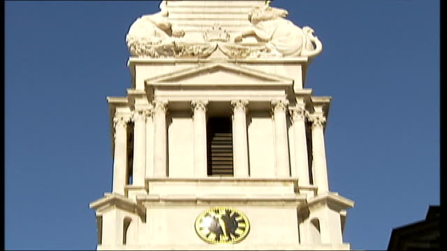 nicholas hawksmoor's 'gin lane' church refurbishment; **music overlaid over following sequence sot** ext st george's bloomsbury tilt up... - steeple stock videos & royalty-free footage