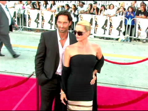 nicholas soderblom and nicollette sheridan at the 'mr and mrs smith' world premiere at the mann village theatre in westwood, california on june 7,... - ニコレット シェリダン点の映像素材/bロール