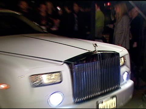 nick cannon arriving in his rolls-royce at the grey goose vodka unveiling of its new customized rolls-royce phantom on january 11, 2007. - ロールスロイスシルバーファントム点の映像素材/bロール