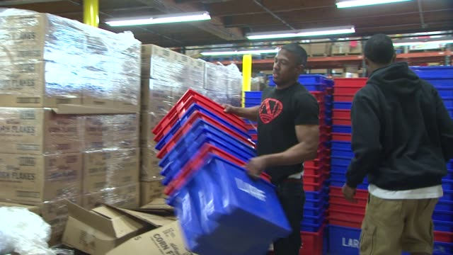 nick cannon at nick cannon and artists from ncredible entertainment support feeding america by volunteering in los angeles ca - nick cannon stock videos & royalty-free footage