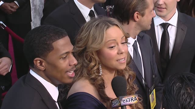 nick cannon mariah carey at the 82nd annual academy awards arrivals part 2 at los angeles ca - hoop earring stock videos and b-roll footage