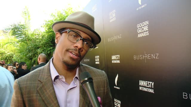 vídeos de stock e filmes b-roll de interview nick cannon on how he got involved hosting this event on how art for amnesty inspires creative activism around the world at art for... - prémio globo de ouro