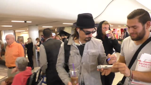 Nick Carter and Kevin Richardson of Backstreet Boys greet fans at Los Angeles International Airport at Celebrity Sightings in Los Angeles on October...
