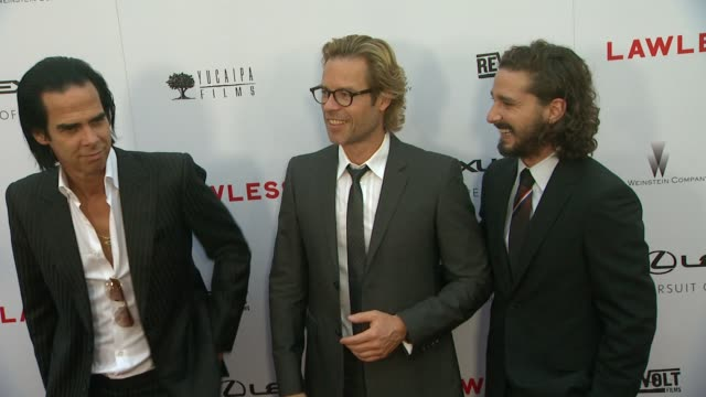 nick cave, guy pearce, shia labeouf at lawless los angeles premiere on 8/22/12 in hollywood, ca. - shia labeouf stock videos & royalty-free footage
