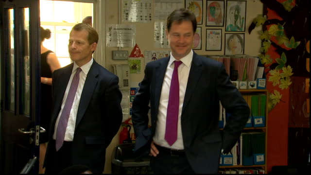 nick clegg in cabinet 'row' over 'free schools' laws and clegg standing next to each other in classroom - ジャッキー ロング点の映像素材/bロール