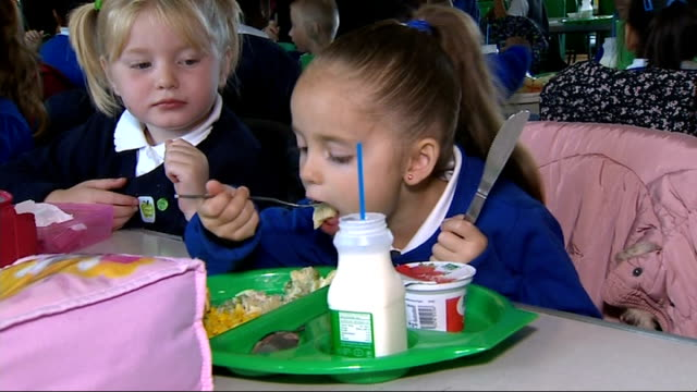 nick clegg launches government's free school meals programme for all under 7s leicester girl eating school meal various of pupils eating vox pops... - school meal stock videos & royalty-free footage