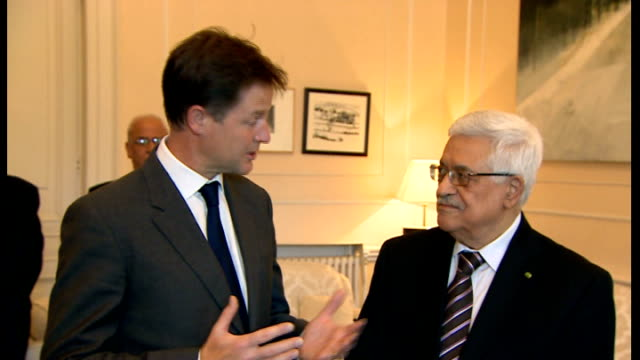 London Whitehall PHOTOGRAPHY** Nick Clegg MP and Mahmoud Abbas arriving in room and shaking hands for photocall / Nick Clegg MP speaking to press SOT...