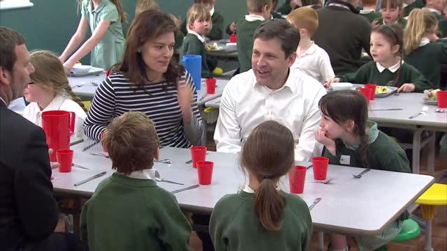 nick clegg & miriam durantez visit ivy lane school in chippenham. shows interior shots miriam durantez & duncan hames talking with schoolchildren... - チッペナム点の映像素材/bロール
