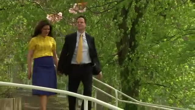 nick clegg miriam gonzalez durantez place their votes at polling station in sheffield shows exterior shots nick clegg wife miriam durantez walk down... - ニック クレッグ点の映像素材/bロール