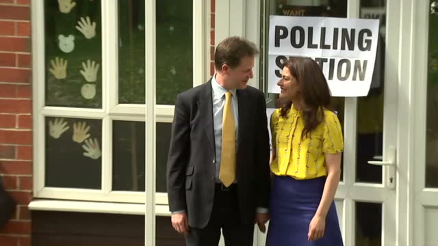 nick clegg miriam gonzalez durantez place their votes in sheffield shows exterior shots nick clegg miriam durantez walk from polling station pose for... - ニック クレッグ点の映像素材/bロール