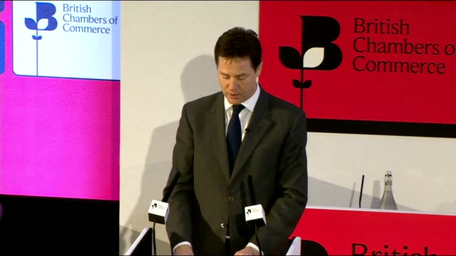 nick clegg speech to british chambers of commerce annual conference; england: london: westminster: int nick clegg mp along to podium and speech sot... - mp stock-videos und b-roll-filmmaterial