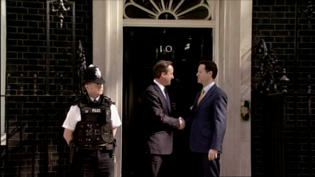 nick clegg threatens veto on nhs reforms lib ext david cameron and nick clegg handshake on number 10 doorstep at start of coalition government - 10 downing street stock videos and b-roll footage