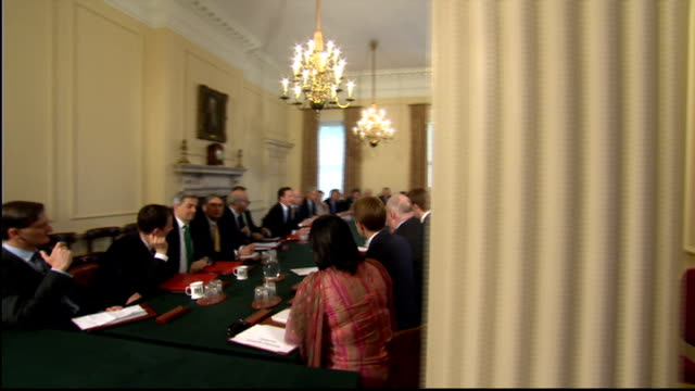 nick clegg threatens veto on nhs reforms lib shot around table at the first cabinet meeting of the coalition government - cabinet stock videos and b-roll footage