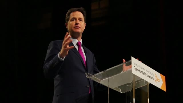 nick clegg uk deputy prime minister and leader of the liberal democrats speaks as he address delegates at the party's spring conference in liverpool... - minister clergy stock videos and b-roll footage