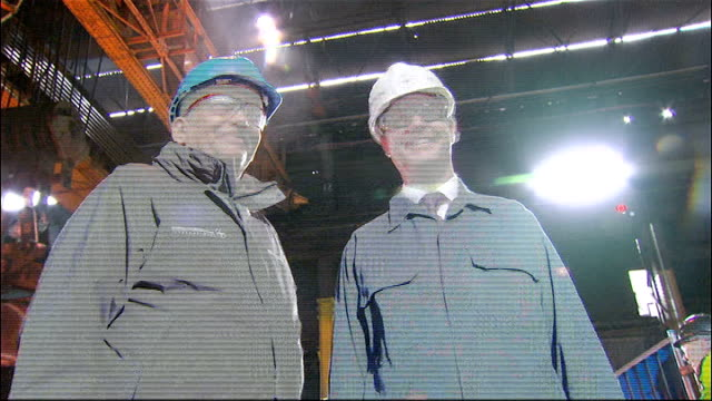 nick clegg visists sheffield forgemasters ** beware close shot clegg in helmet and goggles / low angle shot clegg and factory worker / various of... - skibrille stock-videos und b-roll-filmmaterial