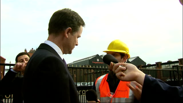 vídeos de stock, filmes e b-roll de nick clegg visists sheffield forgemasters various general views of clegg with factory workers / sheffield forgemasters steel factory gates / steel... - sheffield