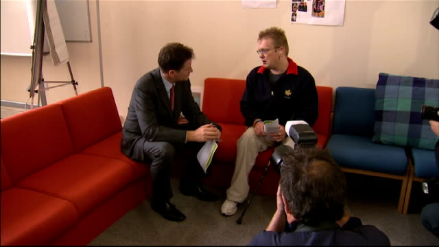 nick clegg visits autistic charity in sheffield university clegg talking to a disabled man about employment sot - employment issues stock videos & royalty-free footage