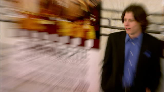 Nick Eversman posing for paparazzi on the red carpet at Paramount Studios