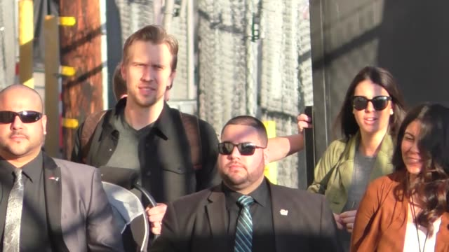 nick foles, the quarterback of the philadelphia eagles, carries his baby into jimmy kimmel live at el capitan theater in hollywood in celebrity... - philadelphia eagles stock videos & royalty-free footage