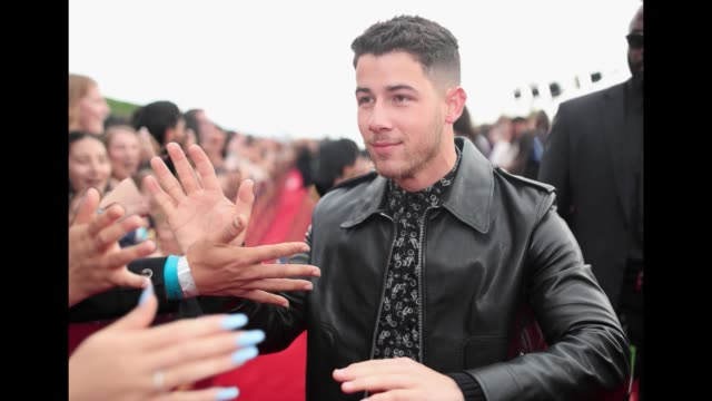 nick jonas attends the 2018 mtv movie and tv awards at barker hangar on june 16 2018 in santa monica california - mtv movie & tv awards stock videos & royalty-free footage
