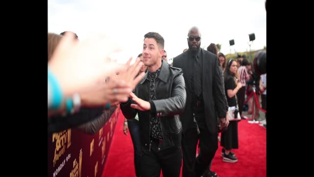 Nick Jonas attends the 2018 MTV Movie And TV Awards at Barker Hangar on June 16 2018 in Santa Monica California