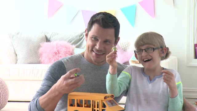 nick lachey and azaliah farkas at nick lachey photo shoot for toys 'r' us toy guide for differentlyabled kids on april 22 2015 in union city new... - nick lachey stock videos & royalty-free footage