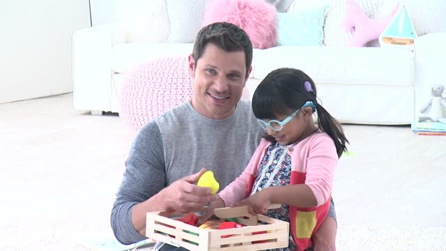nick lachey and guest at nick lachey photo shoot for toys 'r' us toy guide for differentlyabled kids on april 22 2015 in union city new jersey - nick lachey stock videos & royalty-free footage
