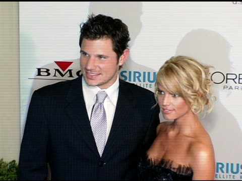 nick lachey and jessica simpson at the clive davis' 2005 pre-grammy awards party arrivals at the beverly hilton in beverly hills, california on... - ニック ラシェイ点の映像素材/bロール