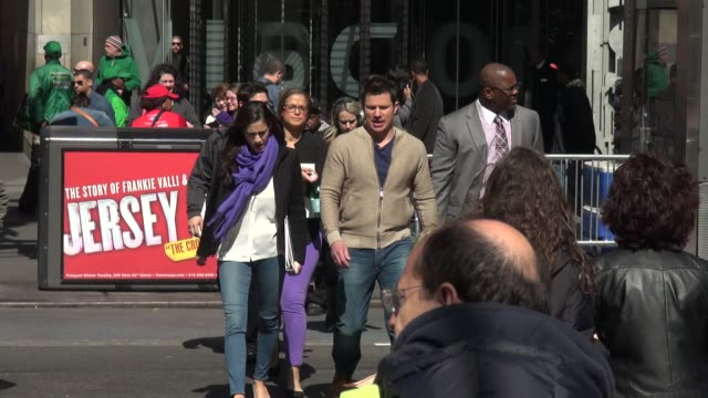 nick lachey, host of vh1's big morning buzz live show crossing broadway in times square to the outside set in celebrity sightings in new york, - ニック ラシェイ点の映像素材/bロール