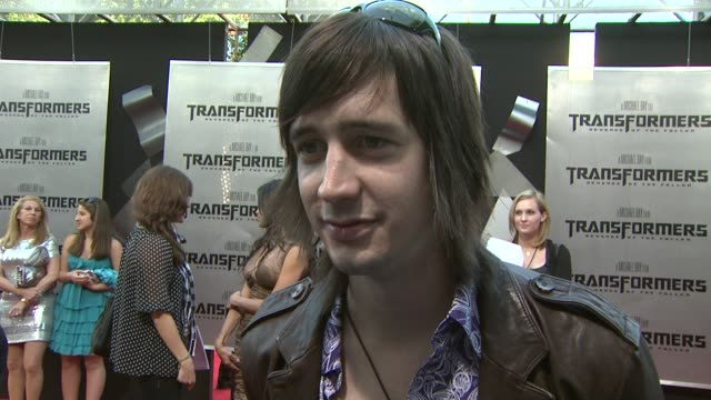 nick wheeler of 'all american rejects' on being on the film's soundtrack, being a transformers fan at the 'transformers: revenge of the fallen'... - the all american rejects stock videos & royalty-free footage