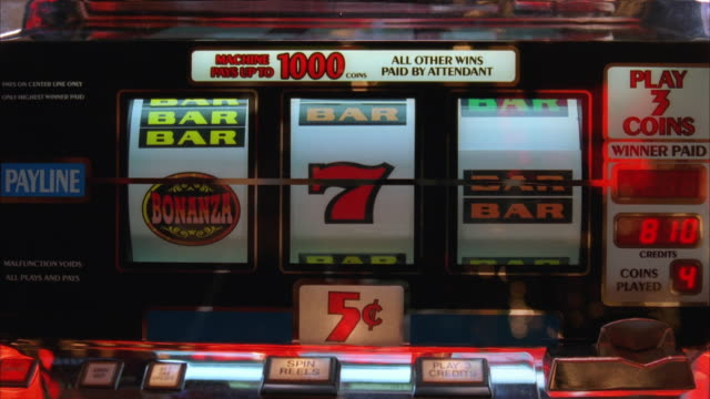 ms nickel slot machine tumblers, as they spin and stop on bar and 7 - five cent coin stock videos & royalty-free footage
