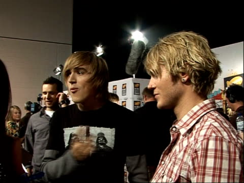 nickelodeon kids choice awards 2008; members of pop band mcfly speaking to press backstage sot - nickelodeon stock videos & royalty-free footage