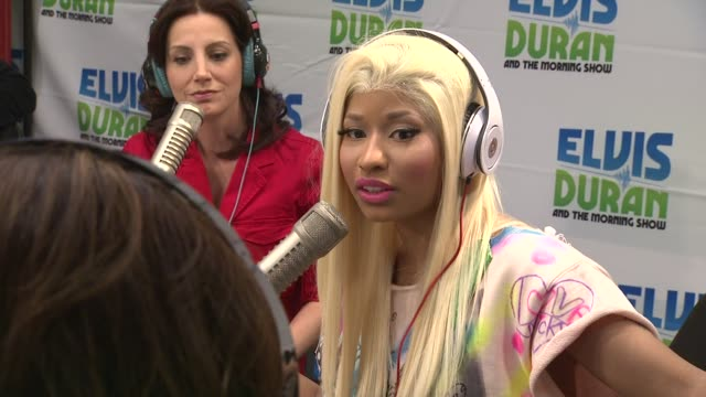 vidéos et rushes de nicki minaj on who was in her first album at nicki minaj visits elvis duran & the morning show on 4/4/2012 in new york, ny, united states. - interview format raw