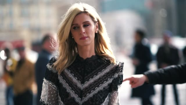 nicky hilton wears a see-through black and white lace dress with a bow at the waist, black pumps, outside giambattista valli, during paris fashion... - waist stock videos & royalty-free footage