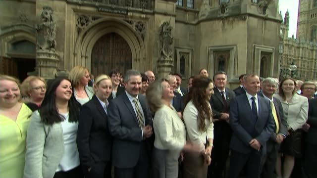 further powers promised for scotland t11051502 / 1152015 england london westmnster ext newlyelected snp mps stand for grou photocall outside houses... - alex salmond stock videos & royalty-free footage