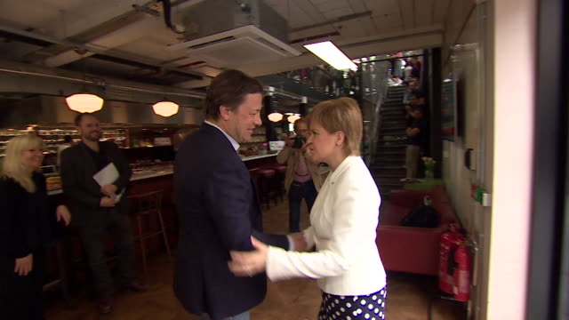 nicola sturgeon and jamie oliver greet each other before talking about tackling obesity in scotland, may 2018. - jamie oliver stock videos & royalty-free footage