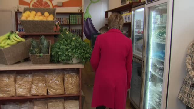 nicola sturgeon campaigning in glasgow and interview; scotland: glasgow: ext nicola sturgeon msp arriving / int various shots of sturgeon walking... - walking stock videos & royalty-free footage