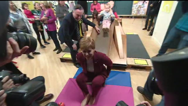 nicola sturgeon launches the snp general election campaign in stirling at children's play centre nicola sturgeon plays with children and goes down... - parlamentsmitglied stock-videos und b-roll-filmmaterial