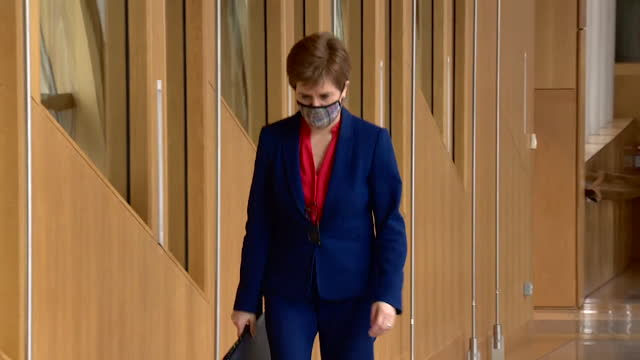 nicola sturgeon msp, first minister of scotland, walking down corridor in the scottish parliament building - walking stock videos & royalty-free footage