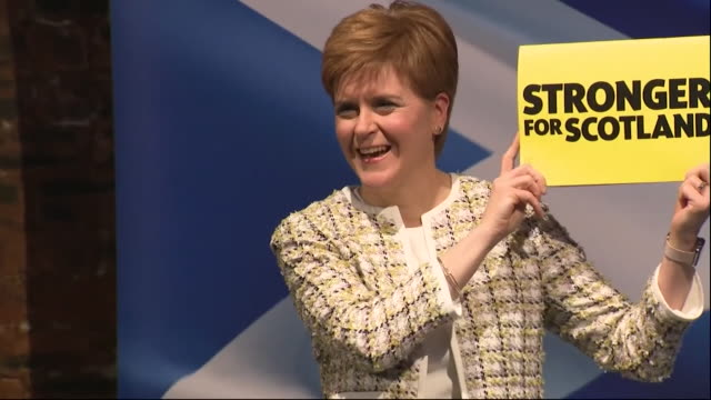 nicola sturgeon poses with the snp's stronger for scotland manifesto at the launch event of it in glasgow - b roll stock videos & royalty-free footage