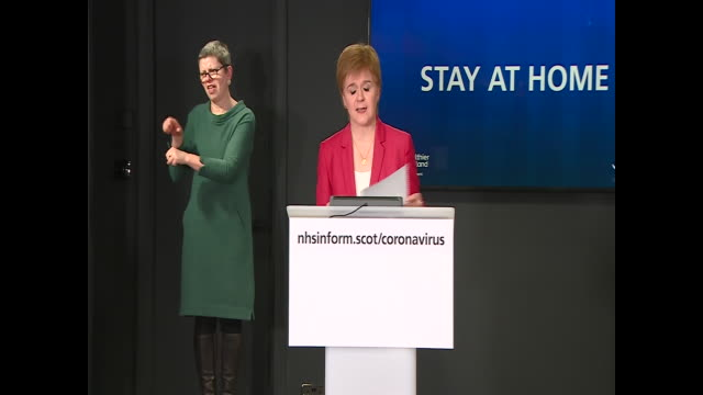 nicola sturgeon saying scotland will not follow boris johnson's 'stay alert' message and that scotland's slogan is still stay at home full stop - placard stock videos & royalty-free footage