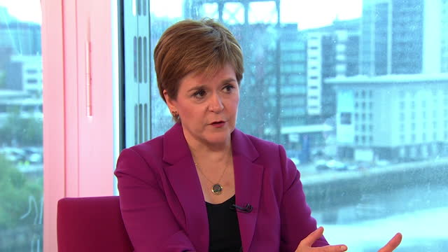 nicola sturgeon saying she will cooperate with boris johnson and other leaders to help the country through the coronavirus pandemic - cooperation stock videos & royalty-free footage
