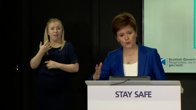 """nicola sturgeon saying there is no doubt that reducing social distancing measures from 2 metres to 1 metre increases the risk of coronavirus infection - """"bbc news"""" stock videos & royalty-free footage"""