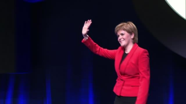 nicola sturgeon says snp mps will back people's vote; scotland: glasgow: int various of nicola sturgeon msp onto stage at snp conference - nicola sturgeon stock videos & royalty-free footage