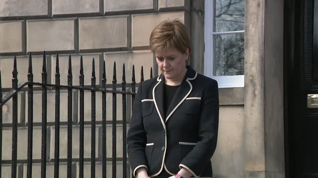 """nicola sturgeon, scotland's first minister, stands outside bute house, edinburgh, and observes minute's silence in tribute to prince philip on day of... - """"bbc news"""" stock-videos und b-roll-filmmaterial"""